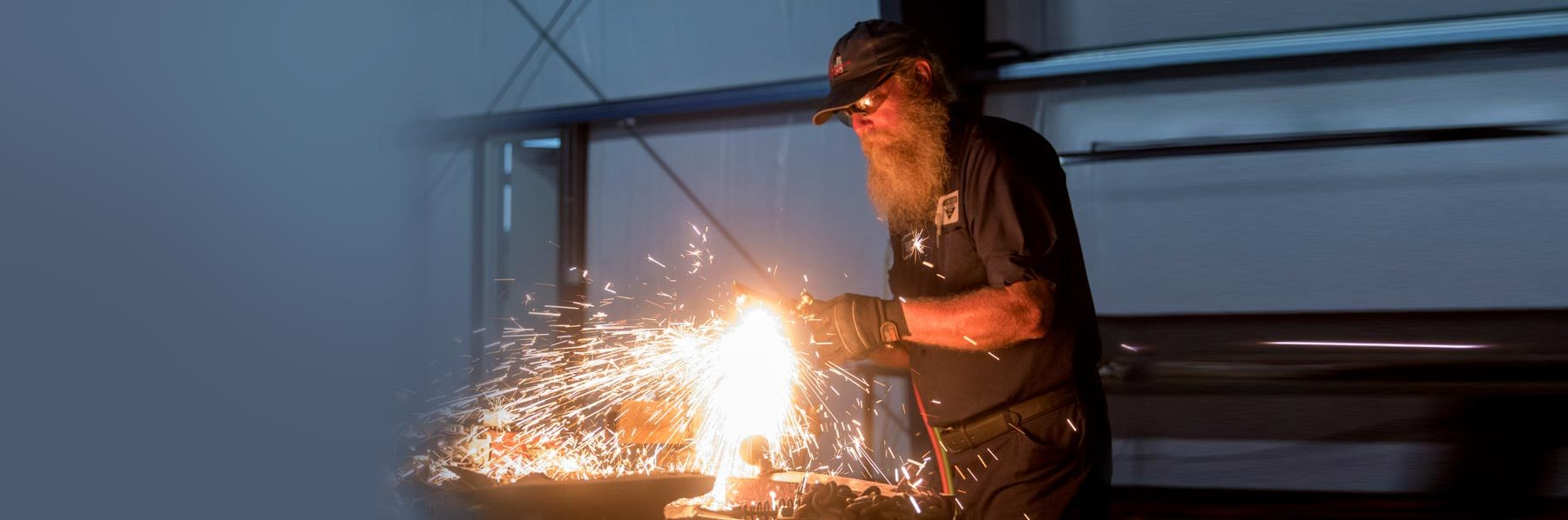 Emporia small business owner Bill Cheever welding in his workshop