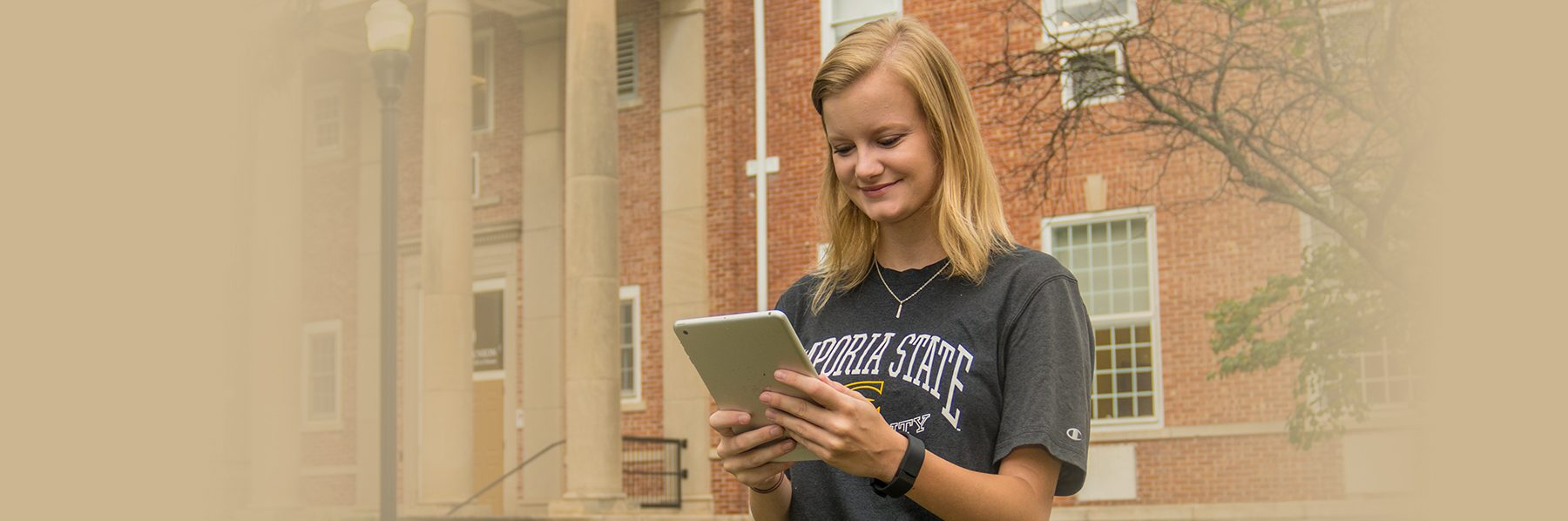 ESU student doing mobile banking with LCSB mobile app